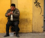 Wood flute street performer