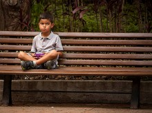 Boy on bench in Venezuela.