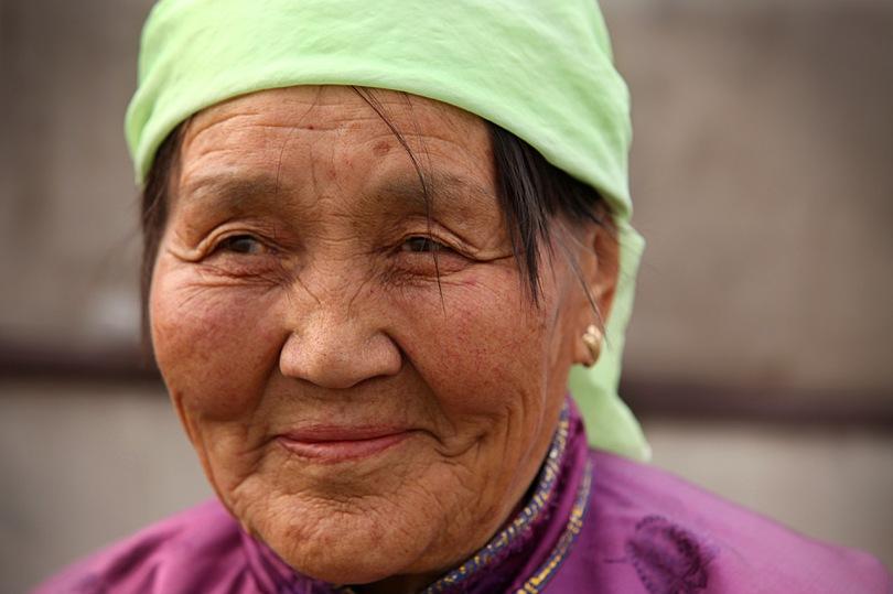 Old Woman checks the lunch menu.