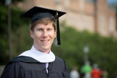 Ryan graduates with two Masters Degrees.