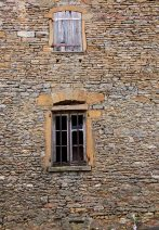 Window frames set in ancient stone walls.