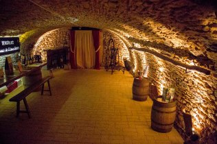 Underground cellars provide a constant temperature for aging wine.