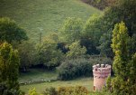 An ancient castle turret still stand watch over the vineyard.