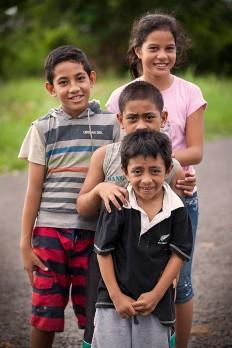 Samoan children pose for the camera.