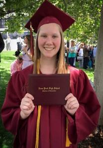 Chloe graduates.