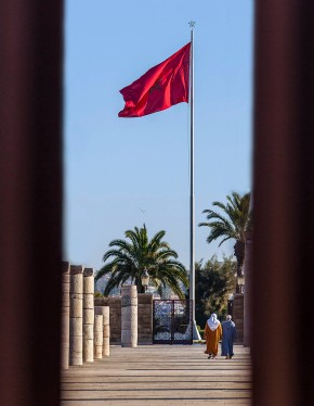 Moroccan Flag and Palace courtyard.