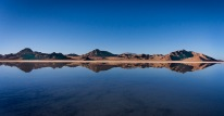Mountain reflections on the water covering the Bonneville Salt Flats.
