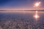 The Sun glistens on water covering the Bonneville Salt Flats.